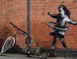 Banksy Artwork of Girl Hula-Hooping With Tire Spotted in U.K. (UPDATE)