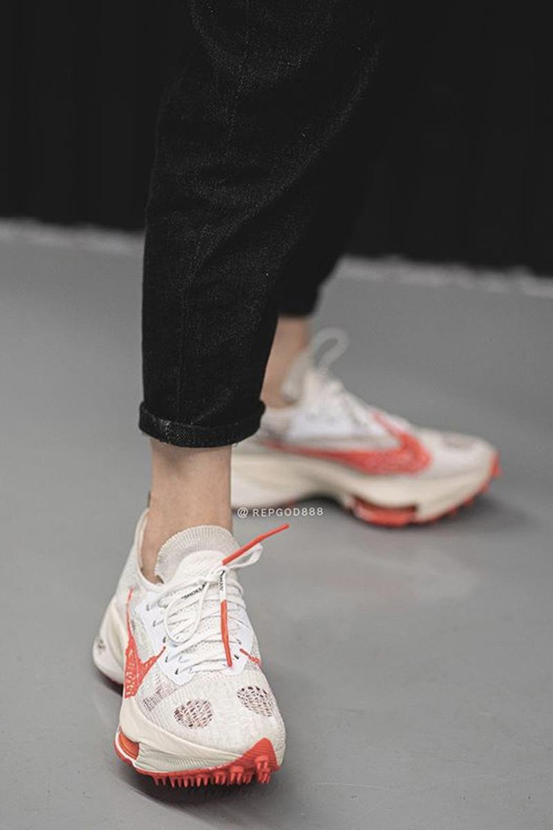 Off-White™ x Nike Air Zoom Tempo NEXT% Beige Off White Red Graffiti Swoosh Virgil Abloh Closer on Foot look Release Drop Date Information Early Pair Sneakers Footwear HYPE Collaboration Limited Edition Rare