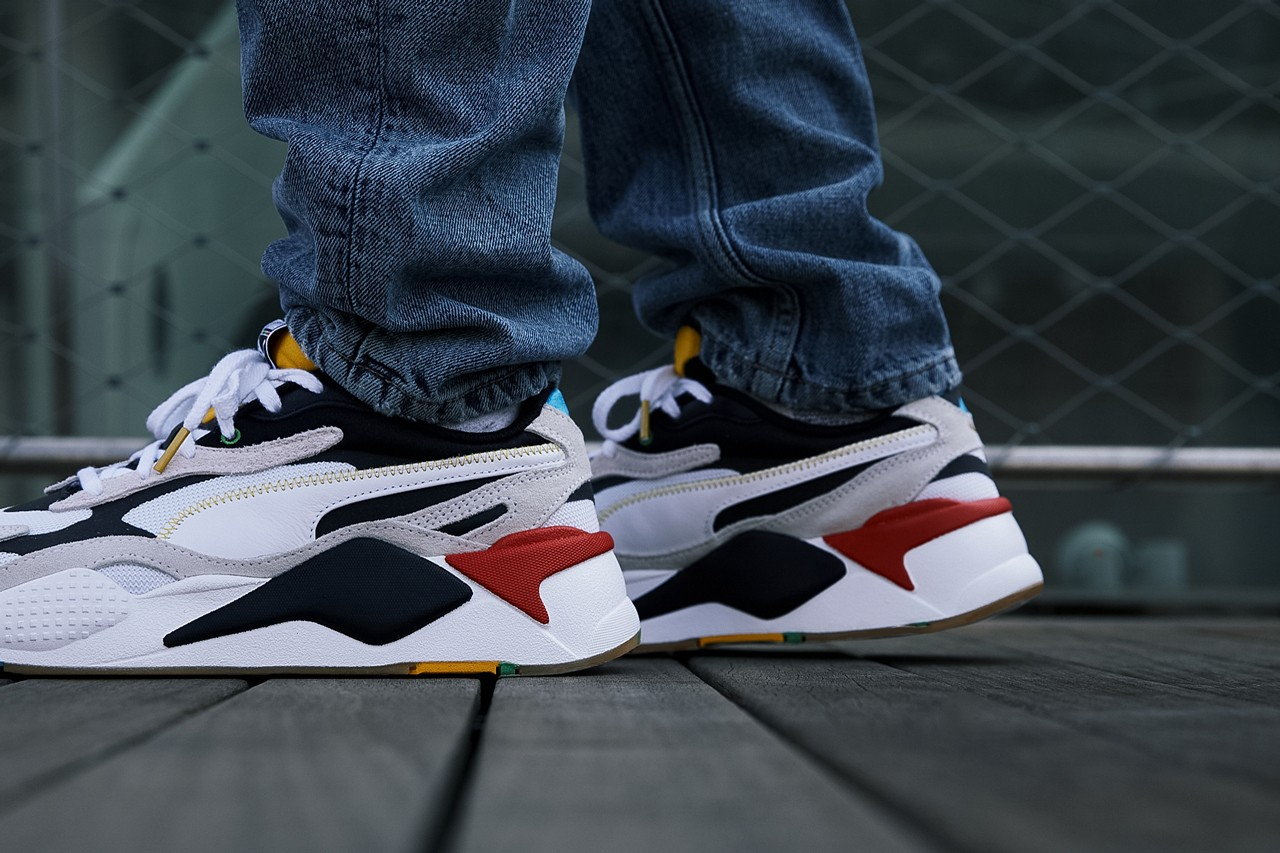 PUMA RS-X³ WH model Salvatore Ferragamo slip-on sneakers horsebit logo red tag on the upper, blue heel tab and yellow tongue unify collection retro future ridged rubber sole and round toe black and gold toned luxury casual options platform sneaker mens womens