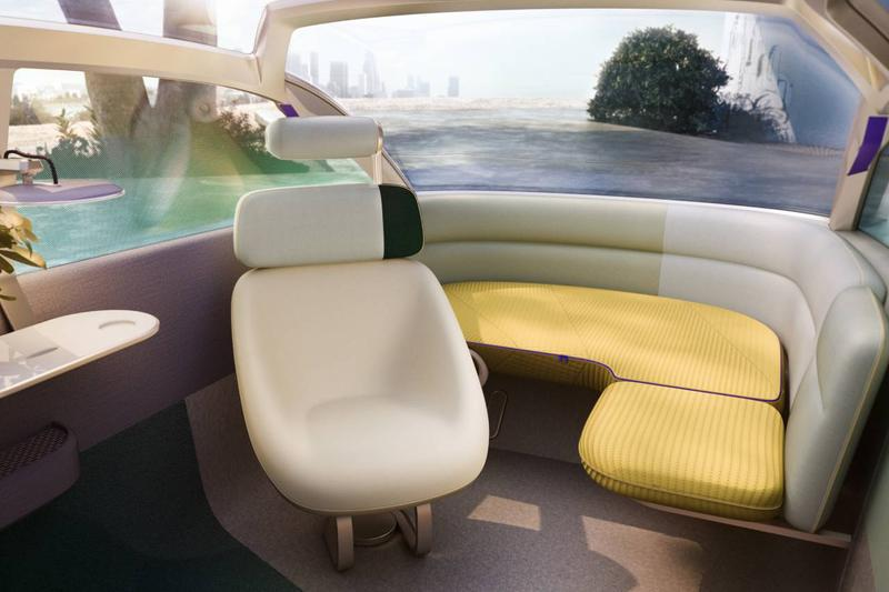 MINI Self Driving Concept Electric Vehicle Vision Urbanaut car interior sofa cozy corner lounge chaise windshield park CAD rendering bmw group
