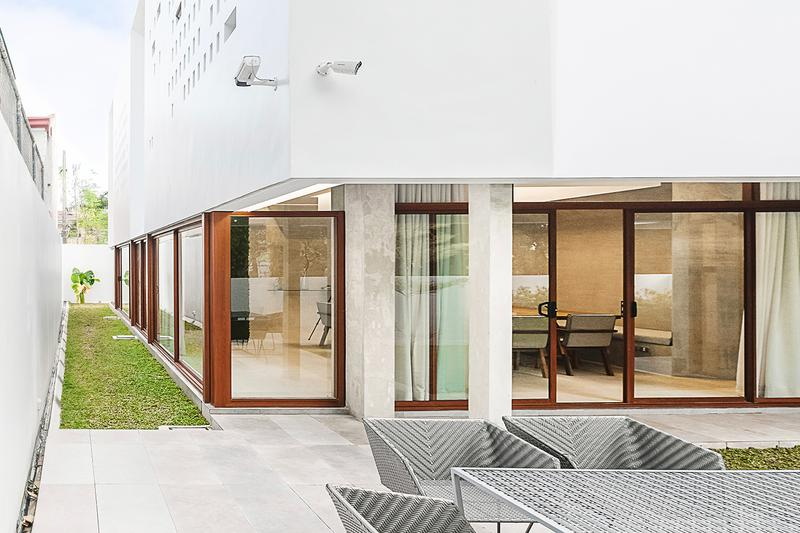 Jim Caumeron Design's VIEWPOINT HOUSE Features Striking Trapezoidal Picture Window Quezon City Philippines Homes Architecture design house minimal