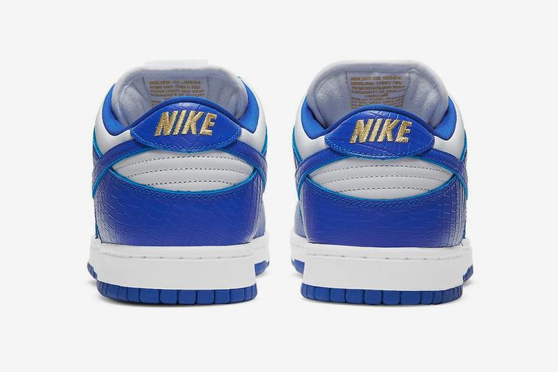supreme nike sb dunk low white hyper royal metallic gold collaboration release info date photos store list buying guide world famous stars