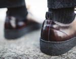 Fred Perry Holdings Acquires George Cox Footwear