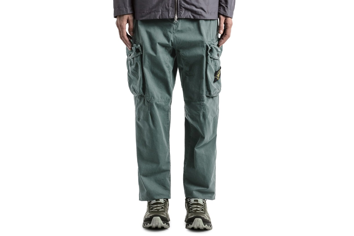 Best Trousers Summer 2021 What to Wear Hot Weather Breezy Wide Leg Floaty Bottoms Pants Bell Bottom Our Legacy Homme Plisse Issey Miyake Designer High Street COS Eckhaus Latta Stone Island Nedews Independent London Brands Acne Studios Eye LOEWE Nature Uniqlo Nike ACG Cottweiler Reebok Luca Magliano