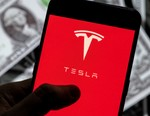 Tesla Hits $1 Billion USD in Quarterly Profit and Louis Vuitton Is Releasing NFTs in This Week's Business and Crypto Roundup