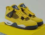 """Unboxing: Jumpman Revives a Yellow Colorway for the Air Jordan 4 """"Lightning"""""""