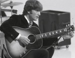 One of John Lennon's Guitars Is Worth More Than a Bugatti