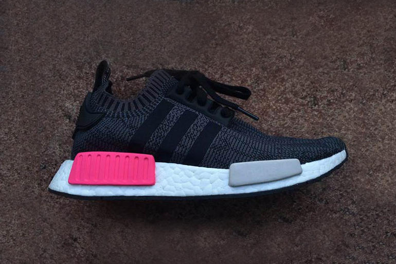 18f3d62f2972 adidas Originals Adds Pink Plug into Black NMD R1