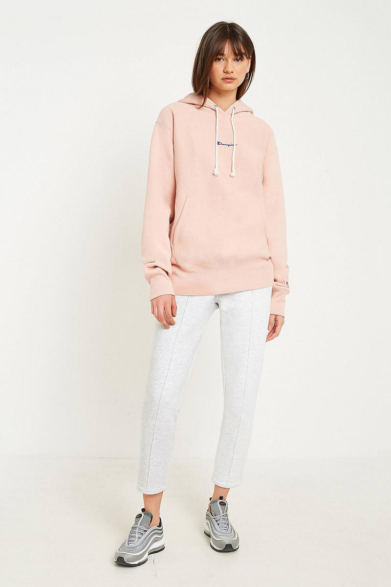 Stay Snug This Winter in Champion s Light Pink Logo Hoodie dcf76b03f