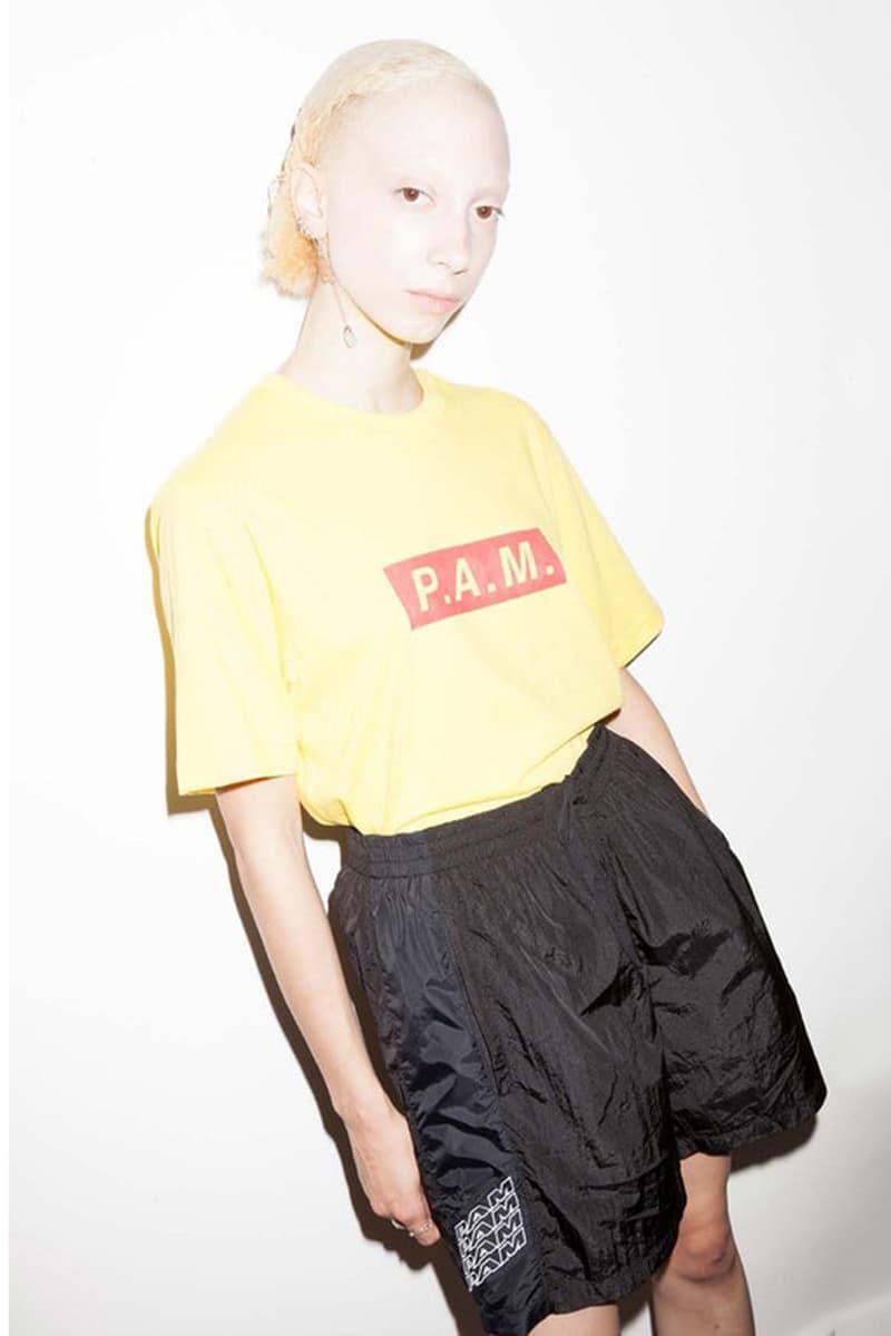P.A.M. Women's Spring/Summer 2018 Lookbook Yellow Logo T-Shirt Black Shorts