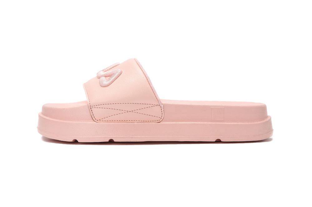 FILA logo millennial pastel pink platform slides drifter jacked up black white summer footwear where to buy