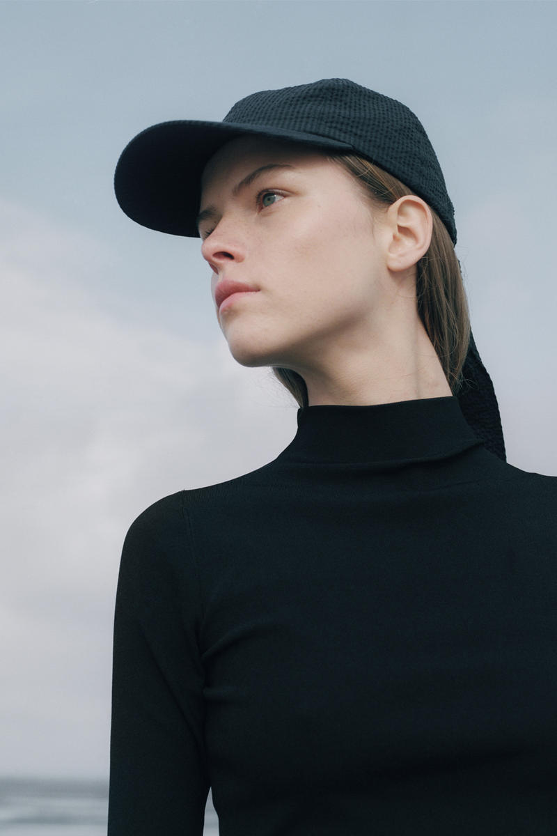 Norse Project Spring/Summer 2018 Collection Lookbook Blue Hat Black Dress Side View