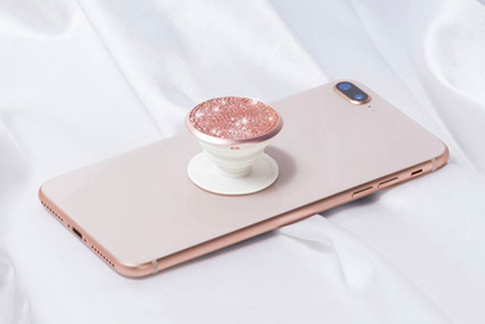 52dc2480a4a7 Swarovski x PopSockets Create Luxe Phone Grips