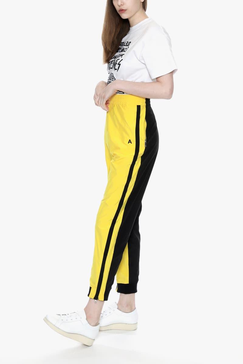 ambush joyce verbal yoon exclusive capsule tracksuit track jacket pants punk white sneakers yellow black tee tshirt