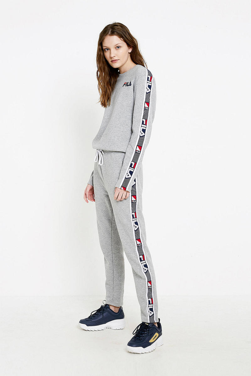 9c1b9f340ed FILA Grey Retro Logo Women s Athletic Jumpsuit Where to buy urban  outfitters cozy one-piece