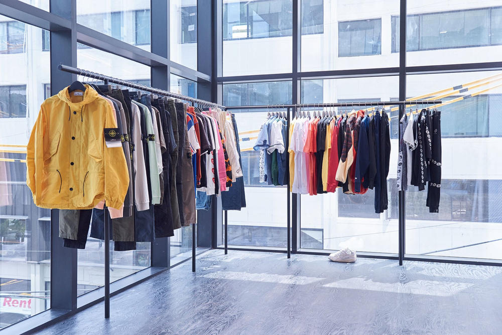 worksout hongdae seoul select shop streetwear collaborations windows clothing racks yellow jacket stone island