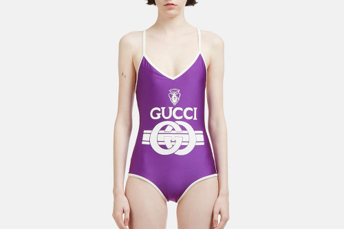 ffc0d6c3d2 Hit the Pool in Style With Gucci s Purple Retro Logo Swimsuit