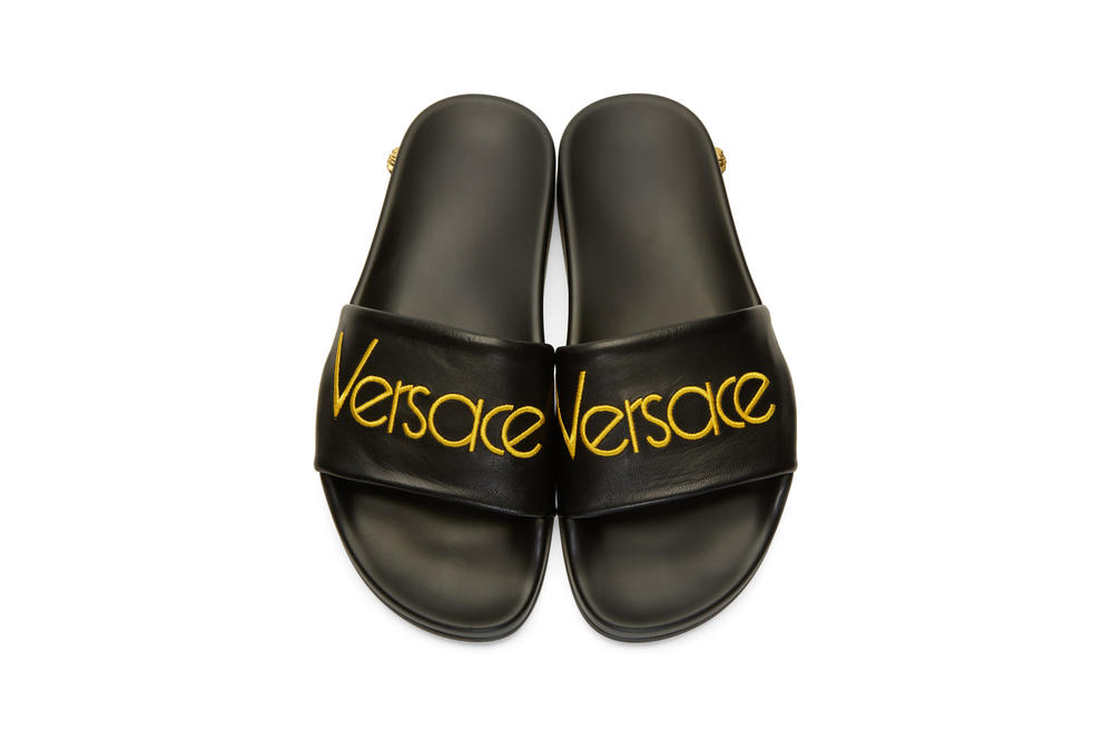 versace black logo tribute slides leather yellow medusa embroidery round toe rubber sole