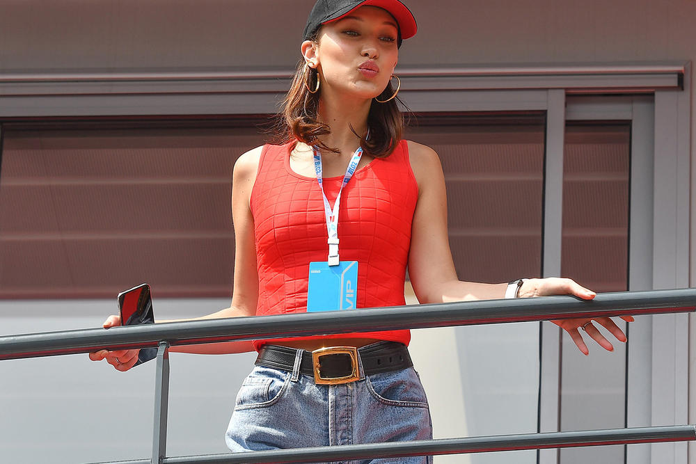 c5ddc45312d Bella Hadid Tag Heuer Watch Monaco Racing Red Chanel Tank Top Prada Belt  Cap Treasures of