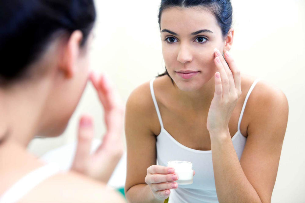 Girl Applying Skincare