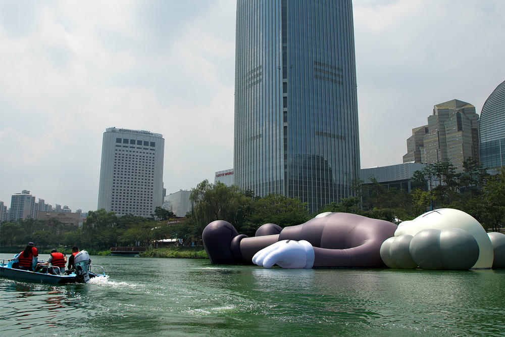 kaws holiday giant floating figure public art seokchon lake