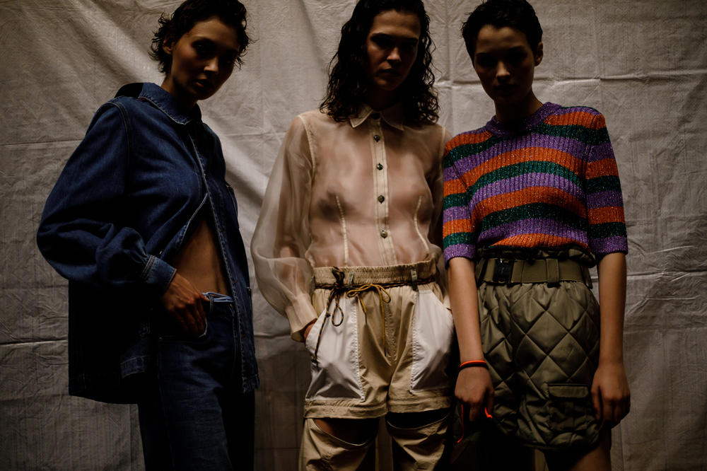 GANNI Copenhagen Fashion Week Backstage Spring Summer 2019 SS19 Denim Jacket Pants Blue Sheer Shirt Tan Striped Top Navy Red
