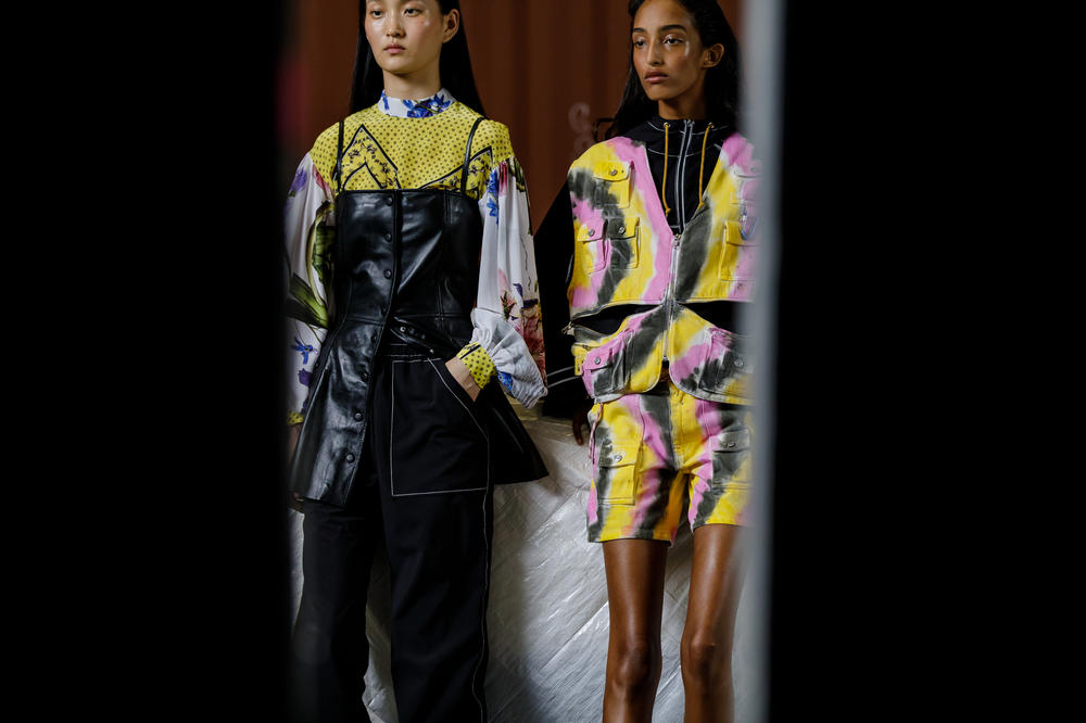GANNI Copenhagen Fashion Week Backstage Spring Summer 2019 SS19 Top Yellow White Bustier Black Tie Dye Vest Shorts Pink