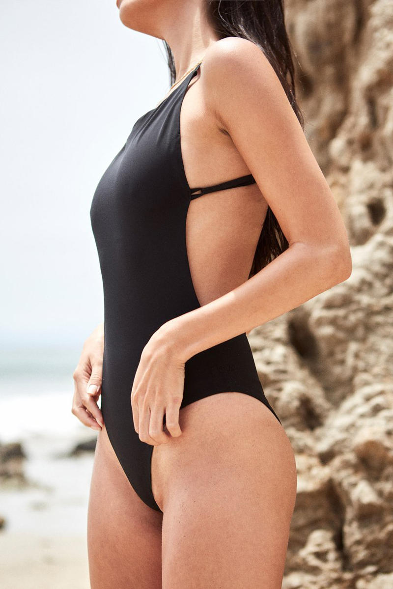 OCIN Swimwear Lookbook One Piece Bathing Suit Black Beach Model