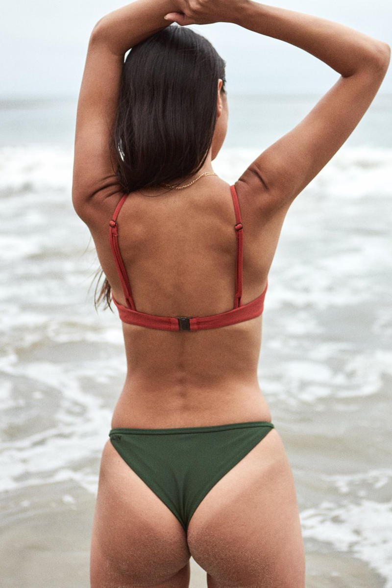 OCIN Swimwear Lookbook One Piece Bathing Suit Cheeky Bottom Green Red Orange Coral Beach Model