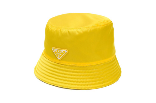Prada Just Dropped an Unforgettable Yellow Logo Bucket Hat 28fc29dfeb1