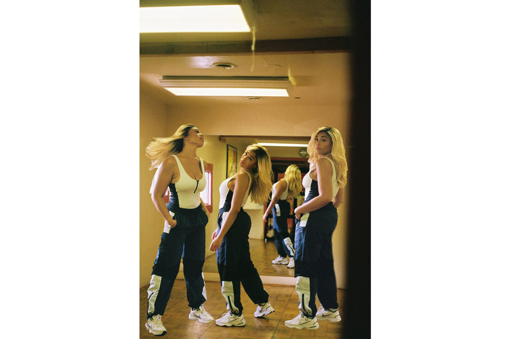 Jordyn Woods Secndnture Activewear Collection Mesh Panel Bodysuit White OVS Classic Windbreaker Pant Blue Black