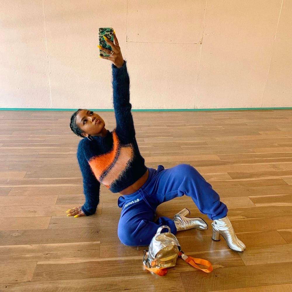 Peggy Gou Acne Studios Scarf YSL Saint Laurent Bag Sunglasses Street Style Justiine Skye Maison Margiela Tabi Boots Silver Heron Preston Backpack Selfie