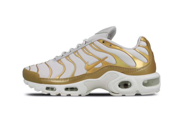 81e76f1c5fa Elevate Your Sneaker Game With Nike s Metallic Gold and White Air Max Plus