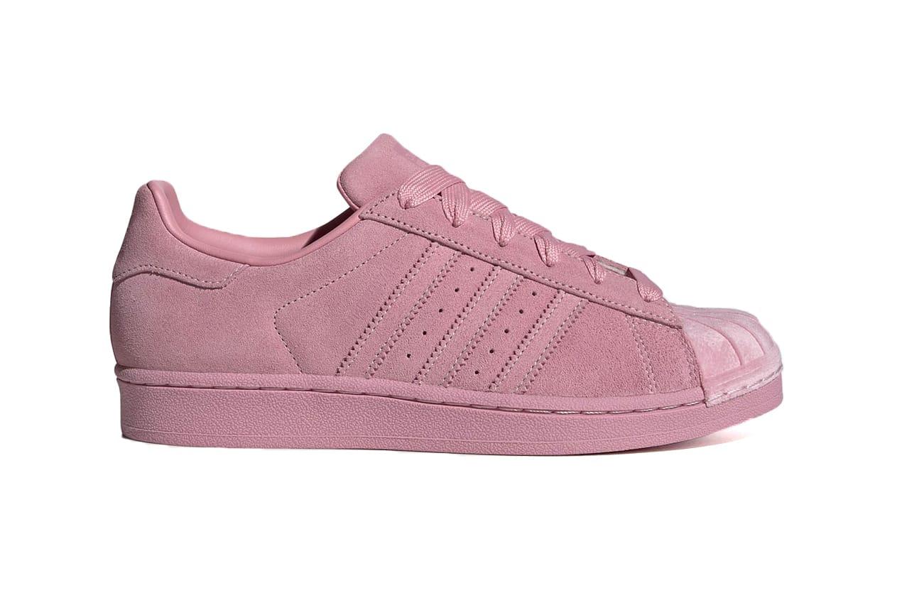 purple and white shell toe adidas