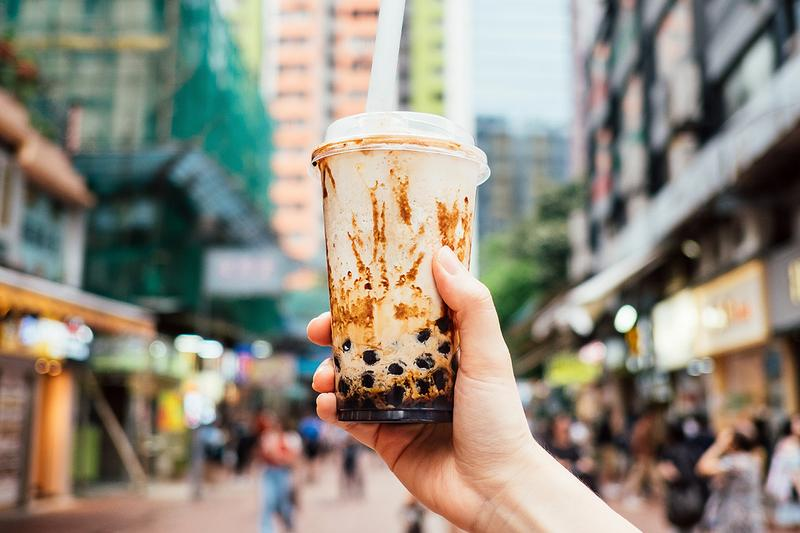 Bubble Tea Tapioca Milk Pearls Brown Sugar Hong Kong Street Taiwanese Drink Beverage Ice Cold Straw Plastic Cup Hand Holding