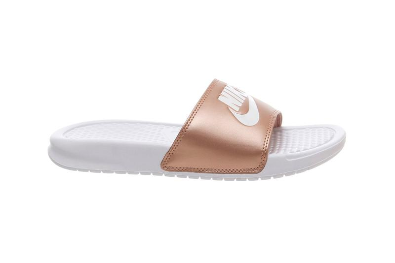 """release date b694e d9448 Nike s Classic Benassi Slides Have a Rose Gold Moment. Do Swoosh in """"Metallic  Red Bronze."""" Nike Benassi Slide Metallic Red Bronze White"""