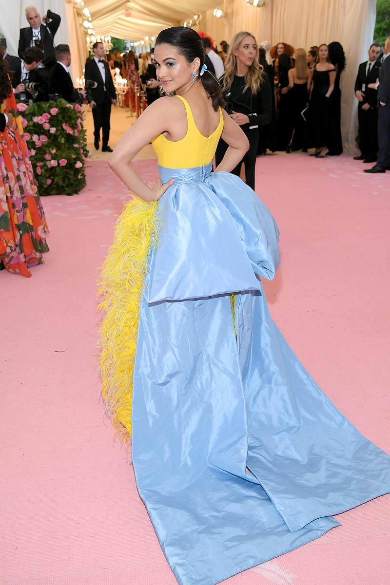 Camila Mendes Riverdale Actress Met Gala 2019 Red Carpet Camp Notes on Fashion Yellow Dress Blue Ribbon Back