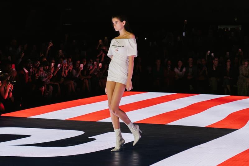 Alexander Wang Spring Summer 2020 Runway Show Rockefeller Center New York American Flag America Designer Model Kaia Gerber White Dress