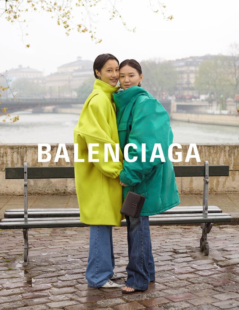 balenciaga winter campaign photos couple yellow coat teal jacket jeans
