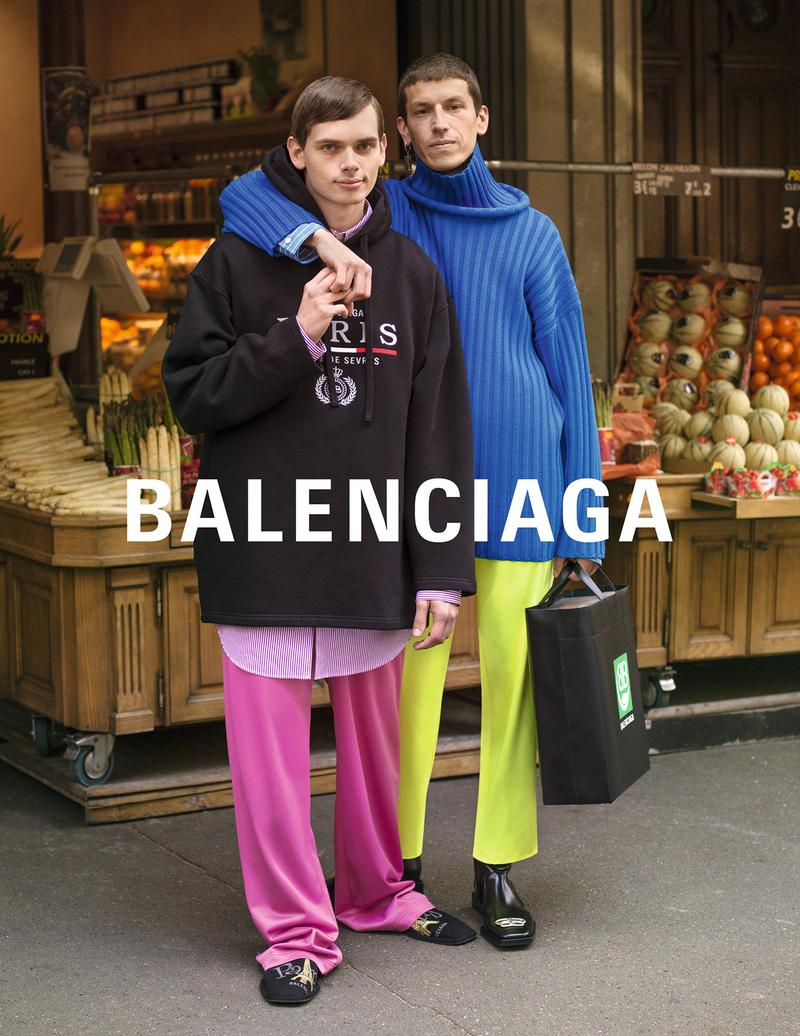 balenciaga winter campaign photos couple cobalt blue sweater lime pants pink black hoodie