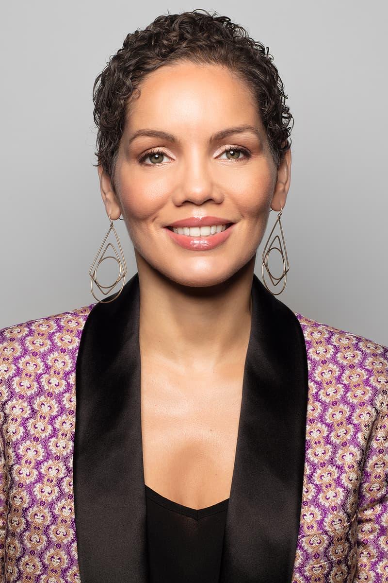 gucci Renée E. Tirado Global Head of Diversity Equity Inclusion earrings makeup curly hair lip gloss