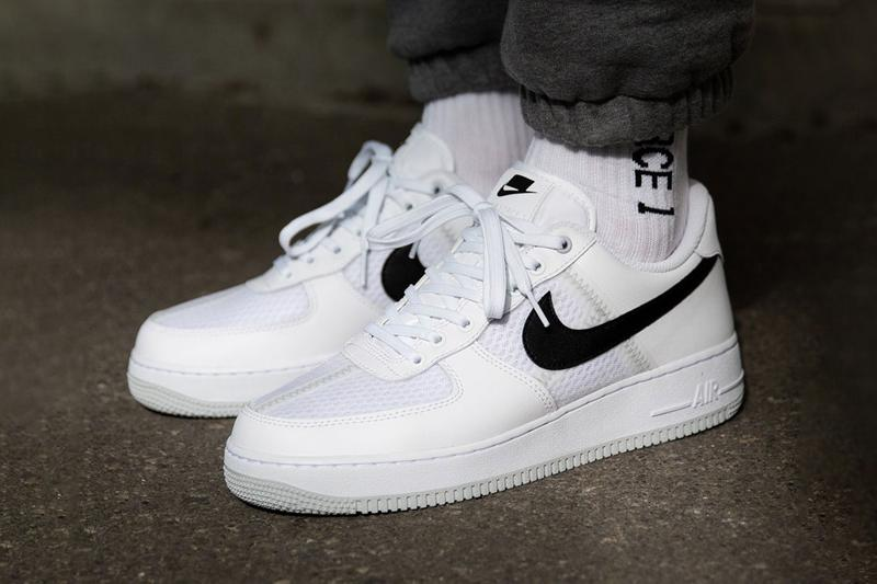 white nike air force 1 black swoosh
