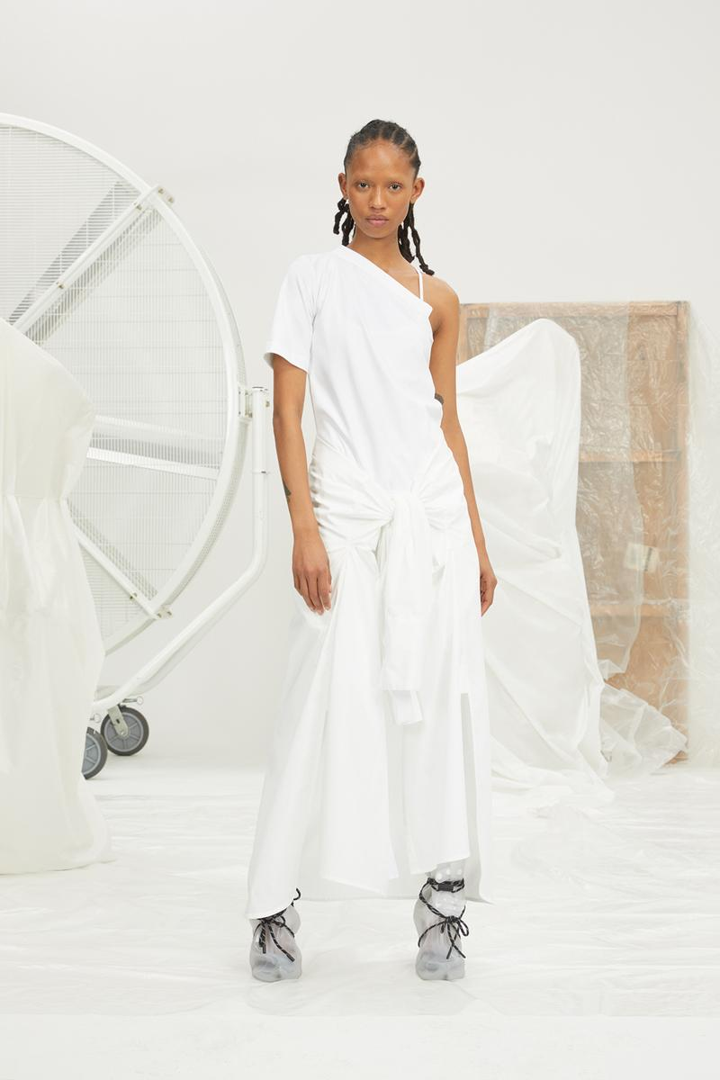 perfect number woman on pedastal Adesuwa Aighewi white shirt pants