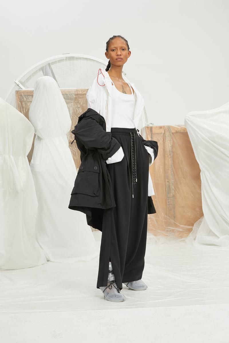 perfect number woman on pedastal Adesuwa Aighewi black and white jacket shirt pants