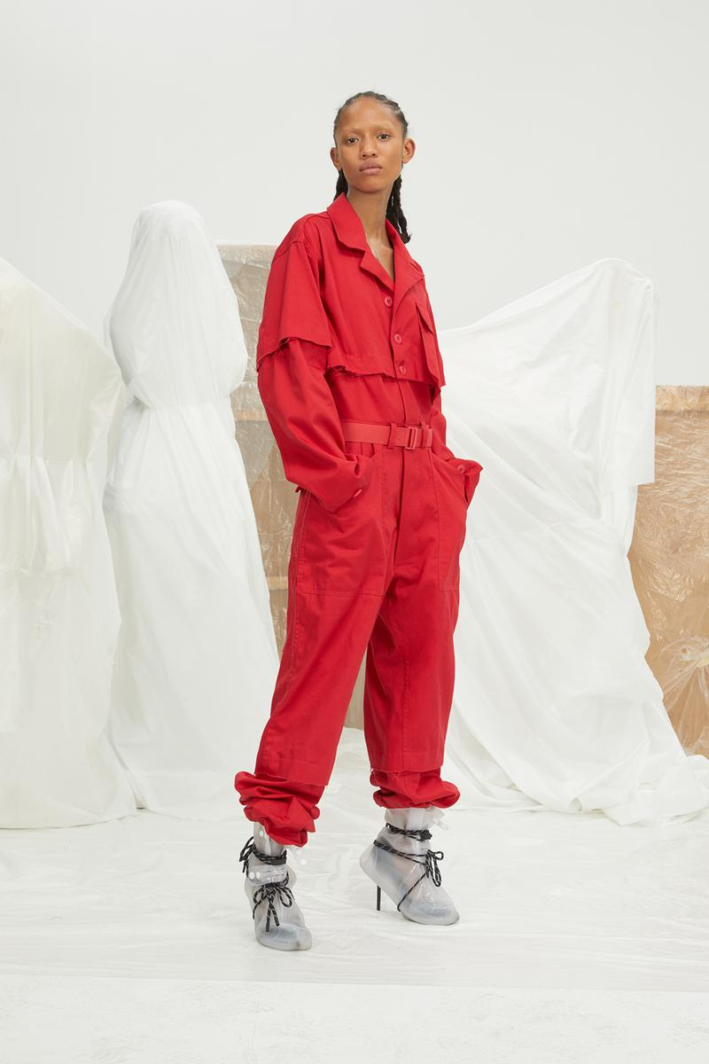 perfect number woman on pedastal Adesuwa Aighewi red flightsuit
