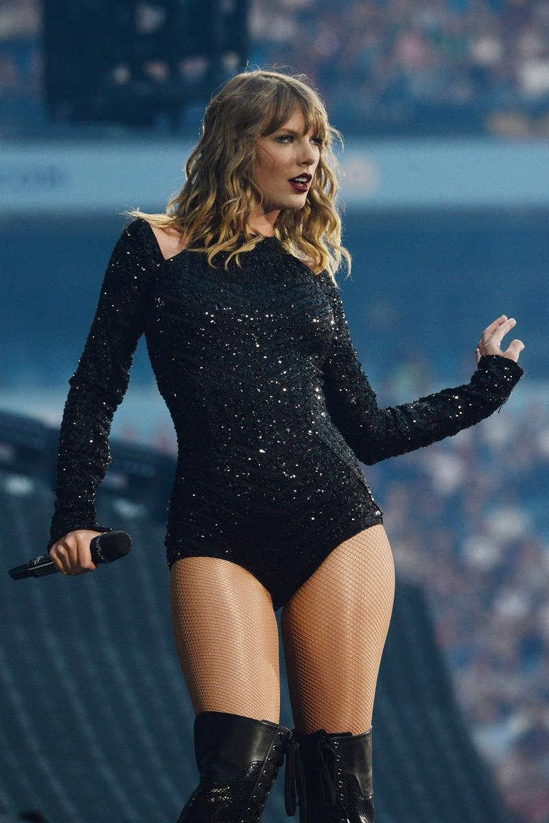 Taylor Swift Reputation Tour Concert Black Outfit Bodysuit Blonde Hair Dark Lipstick Performing Singing