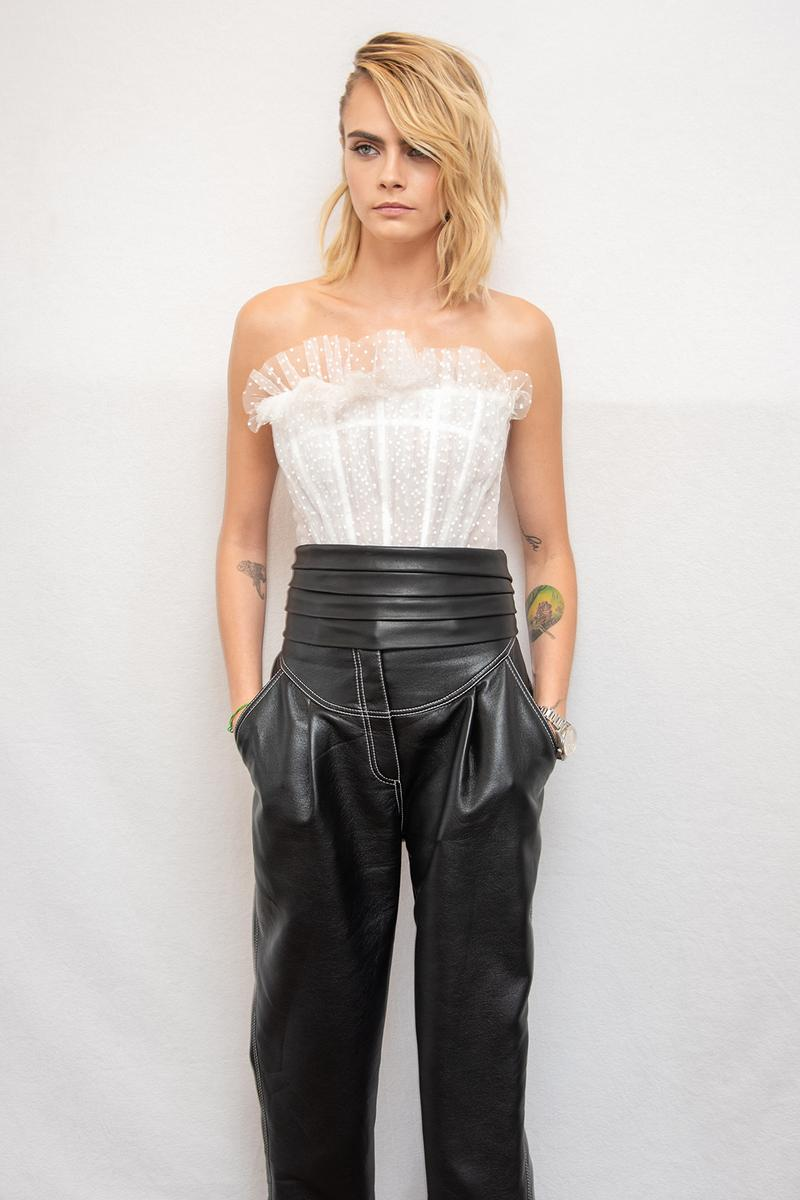 cara delevigne white shirt ruffles leather pants blonde hair celebrity model actress carnival row amazon press conference