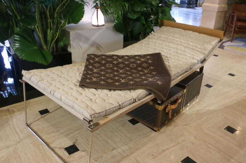 Louis Vuitton Hard Sided Trunks Preview Entrance Couch Blanket Grey Brown