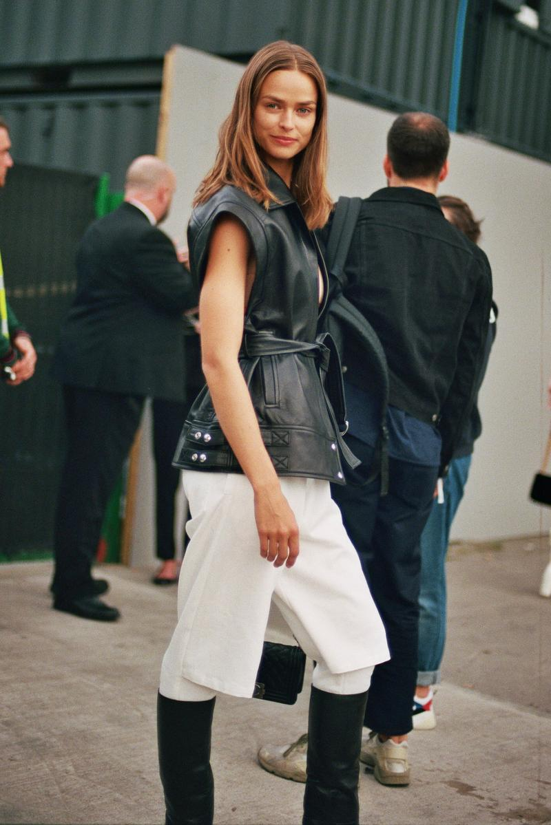 model off duty style spring summer 2020 black leather vest white pants boots