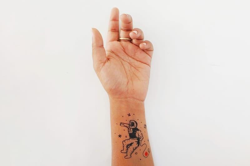 tattoo artist hand arm minimal astronaut art design chicago tattoo artists studios art